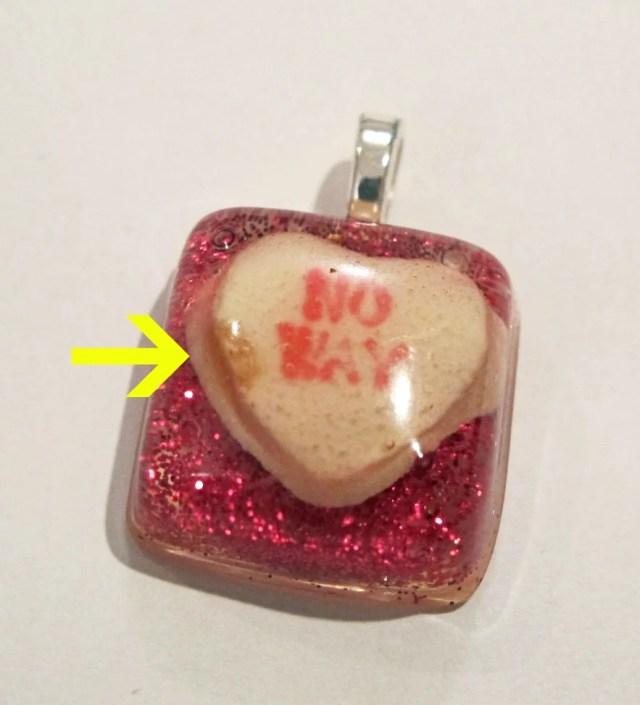 blemished resin pendant
