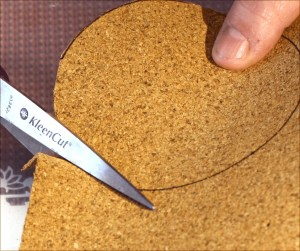 cutting a cork base to fit a resin coaster mold