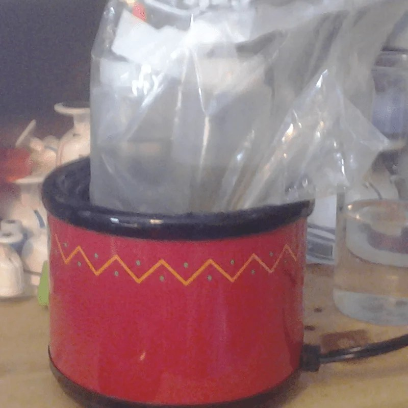 warming resin in a small crock pot