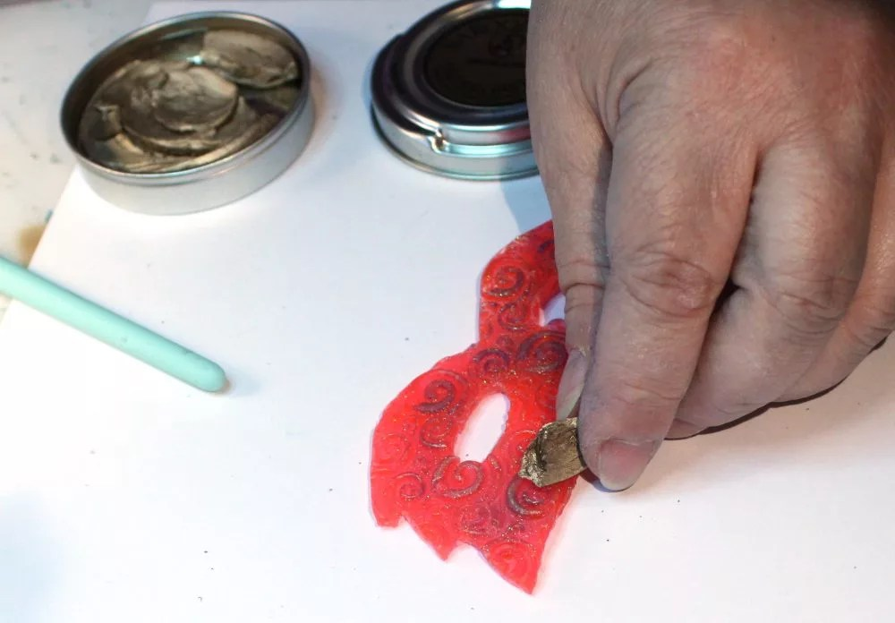 rubbing gilders paste on cured resin