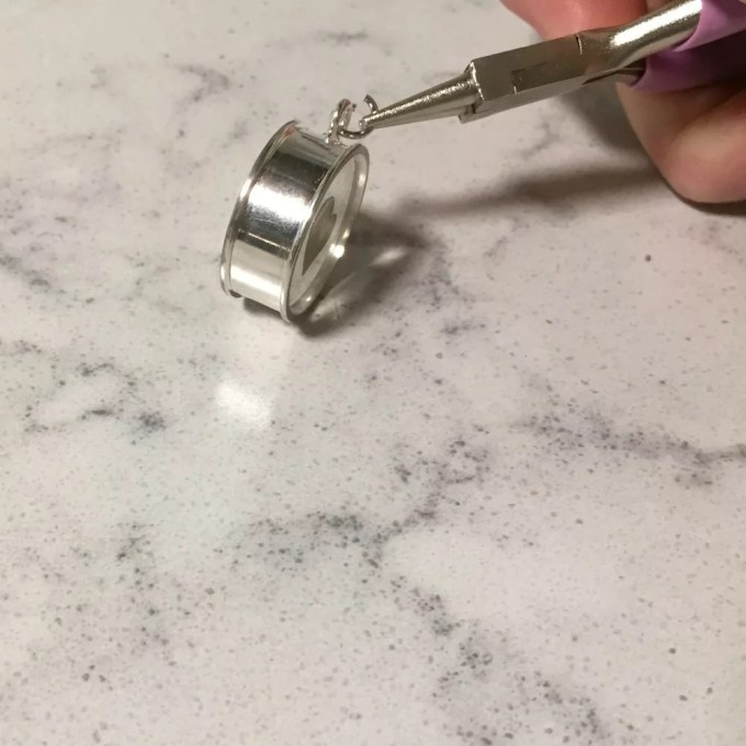 attaching a jump ring to an open backed bezel pendant