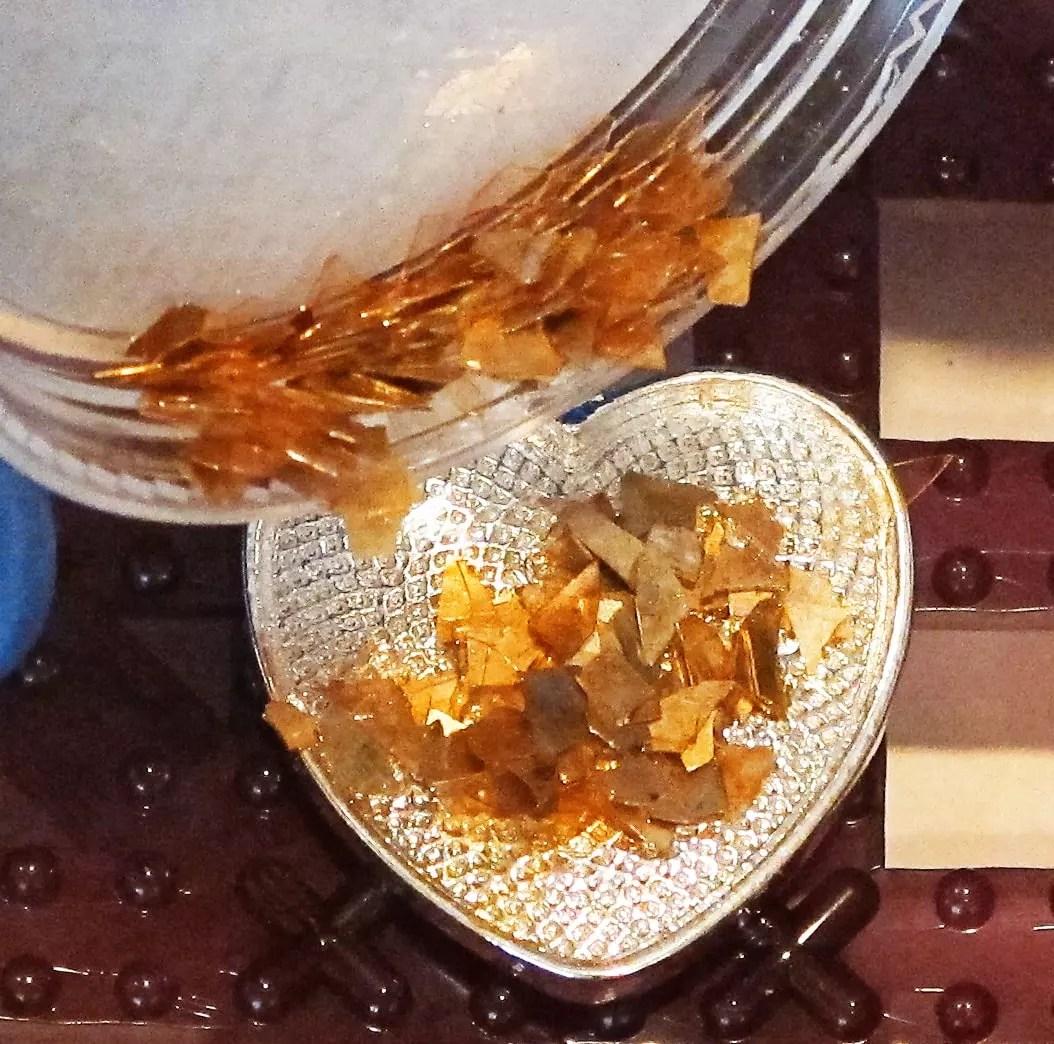 glass glitter shards in a resin pendant