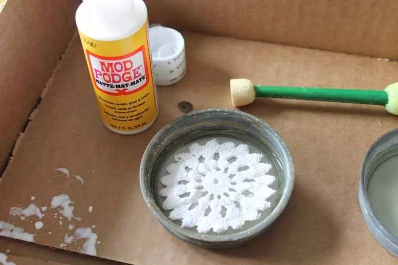 glue doilie into mason jar lid