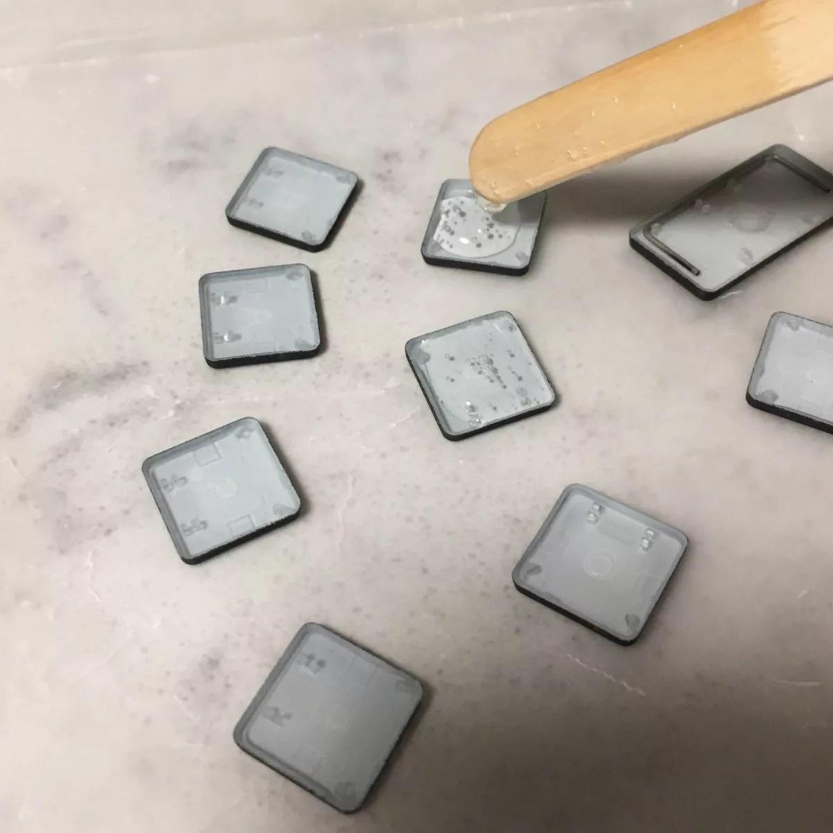 filling backs of keyboard keys with resin