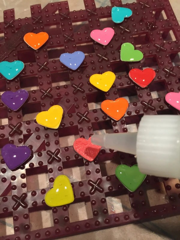 doming resin on paper hearts