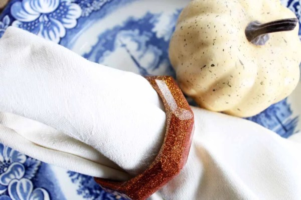copper glitter resin napkin rings with festive place setting