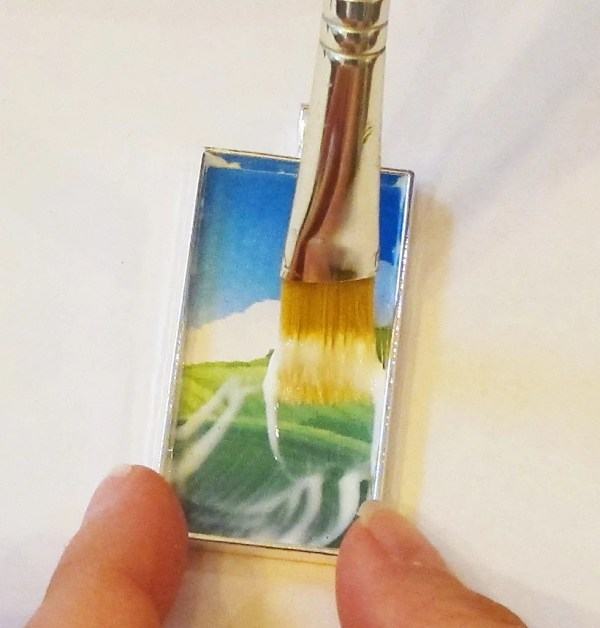 adding glue to a clip art within a pendant