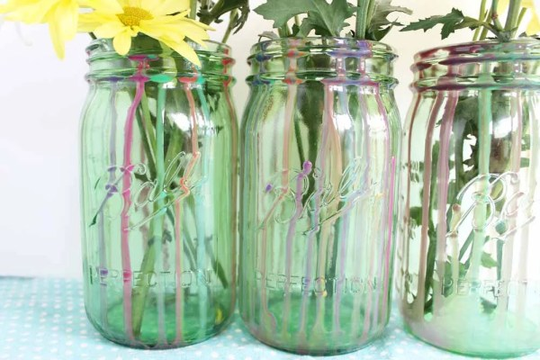 finished dripped resin on mason jar with flowers in jar