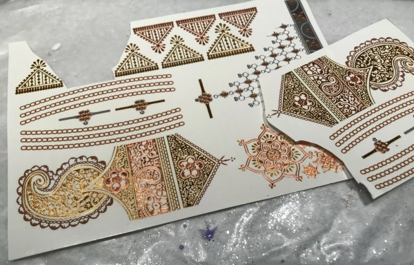 Gold mandala and other India-inspired temporary tattoos