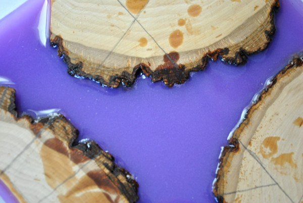 pieces of wood in lavender resin with cut measurements drawn in pencil