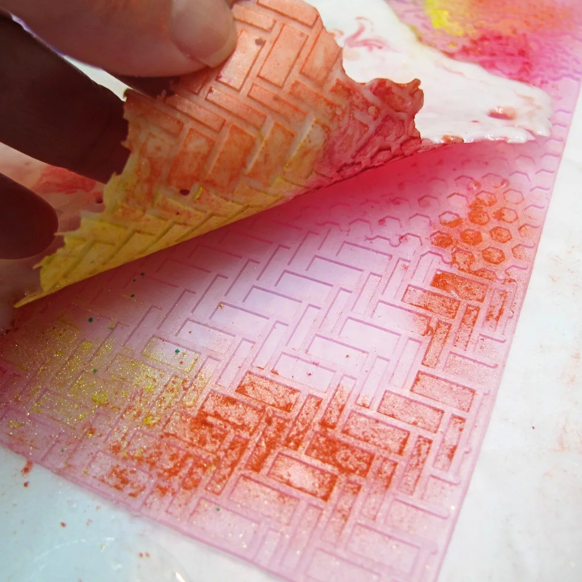 Peeling resin away from a rubber pad