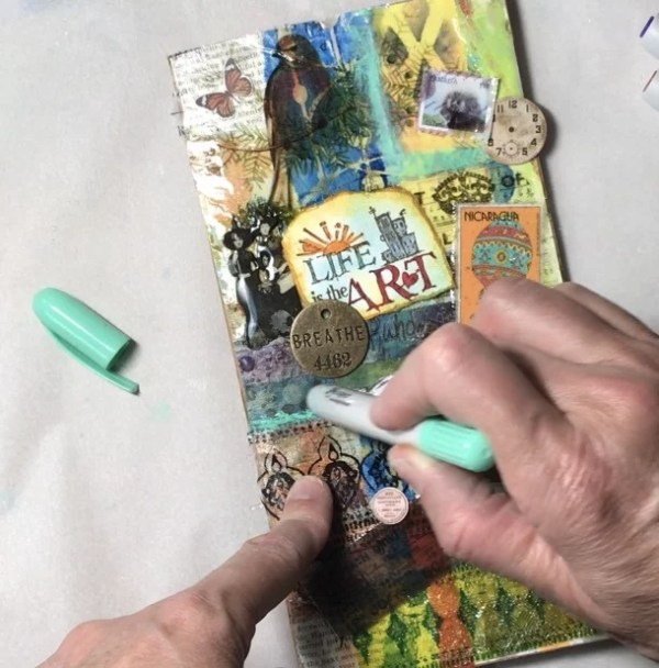using distress crayons on resin art journal cover
