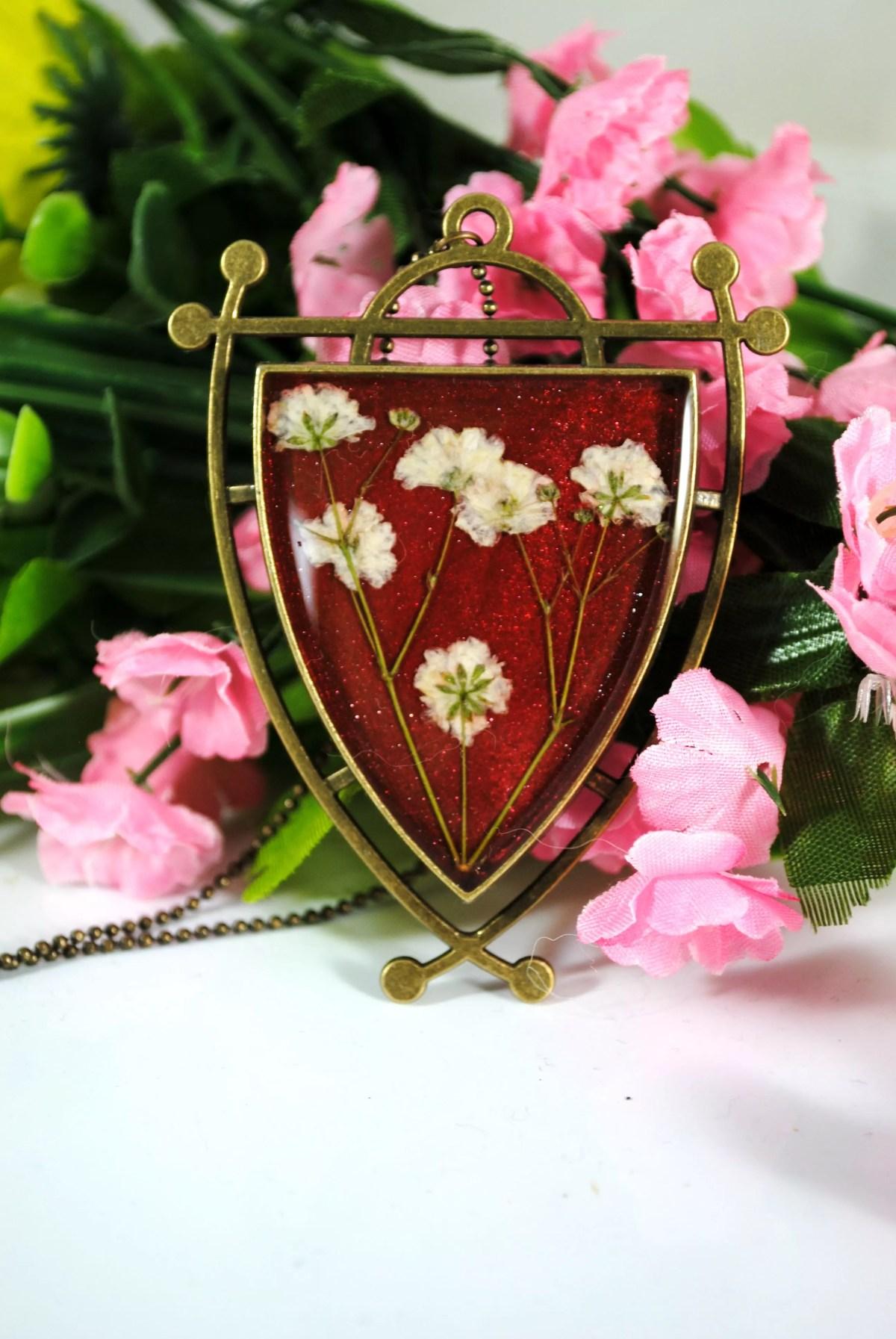 finished resin flowerr pendant