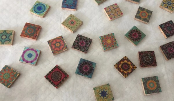 wooden tiles with mandala transparencies affixed