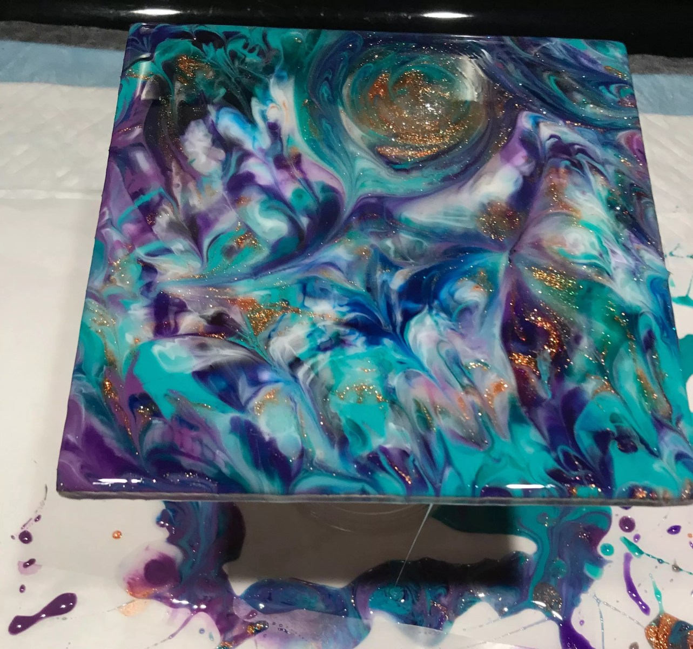 leftover resin poured on wodden canvas