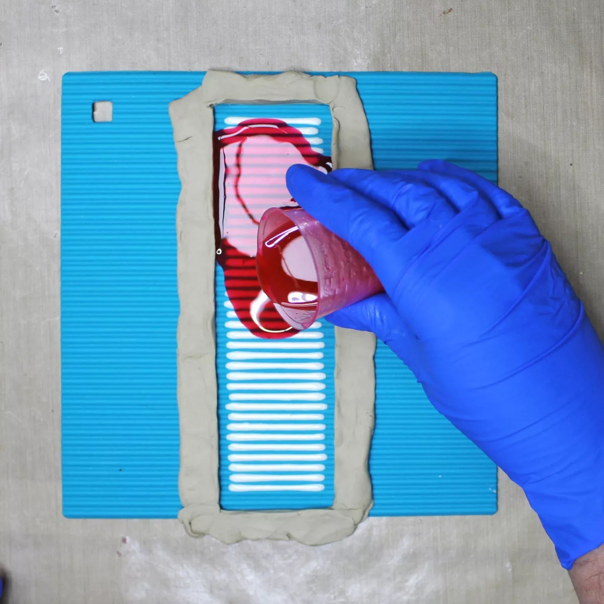 pouring resin onto a silicone mold