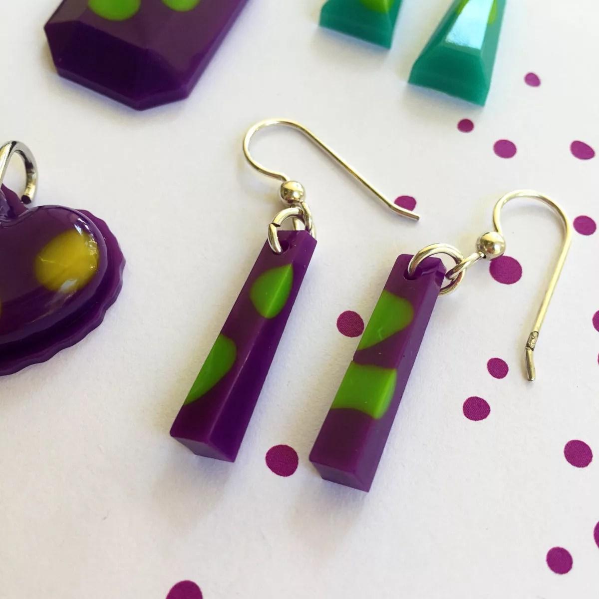 purple and green resin earrings