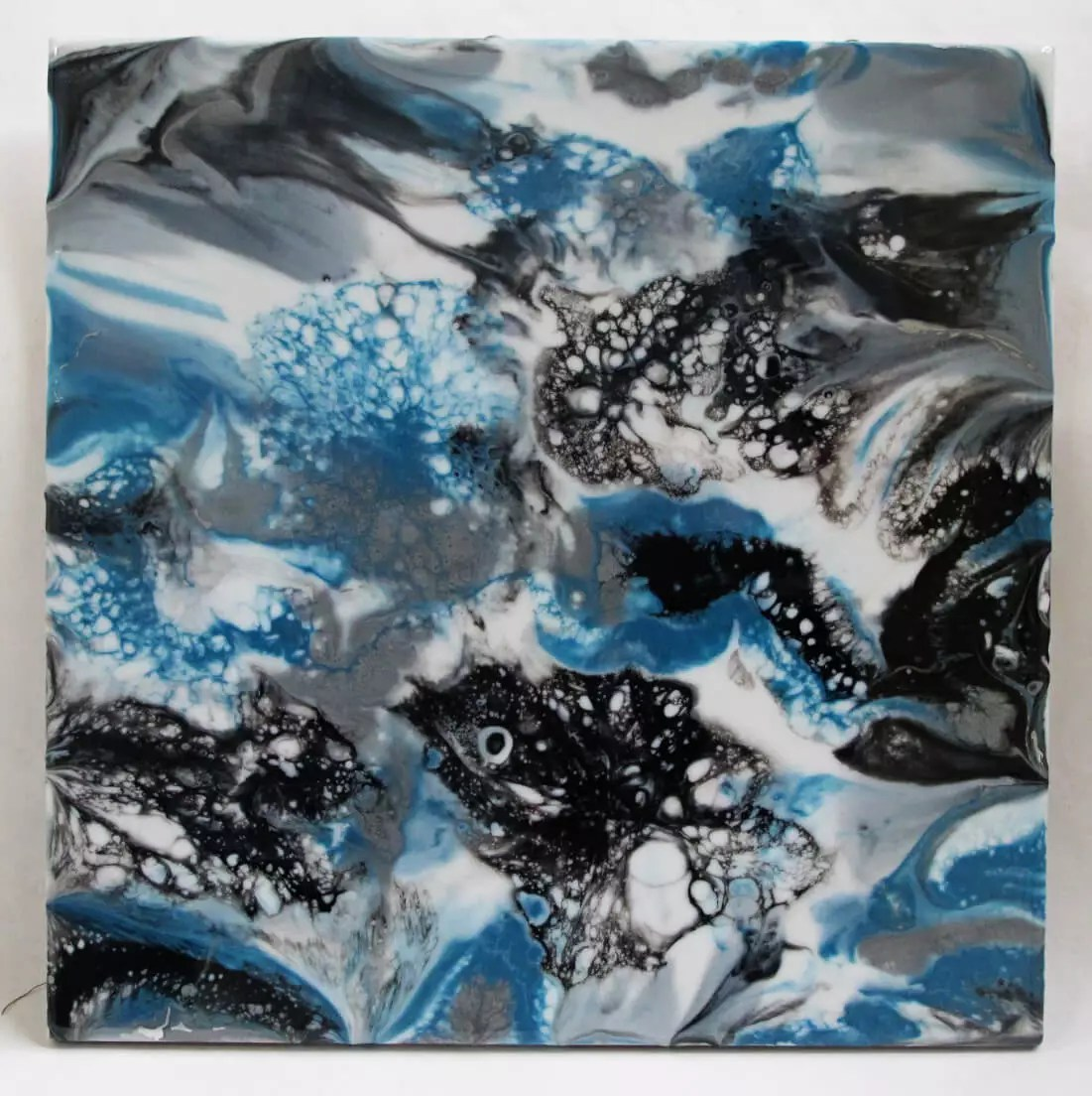 resin painting direct pour with cells black blue white silver