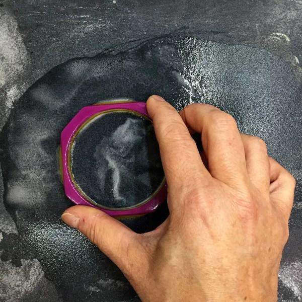 sanding a resin bracelet