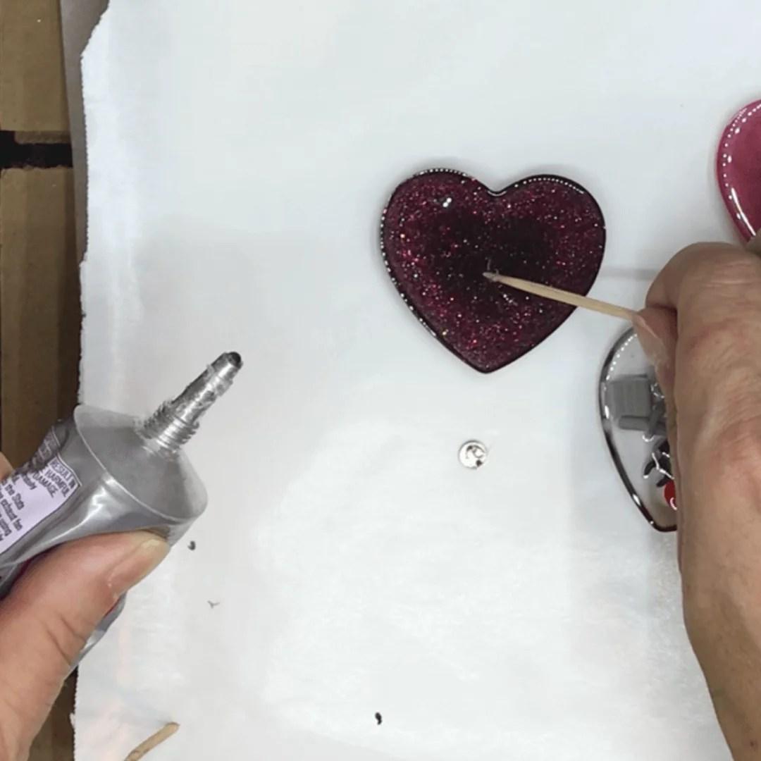 adding e6000 glue to a resin charm