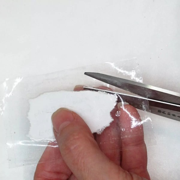 trimming away excess packing tape