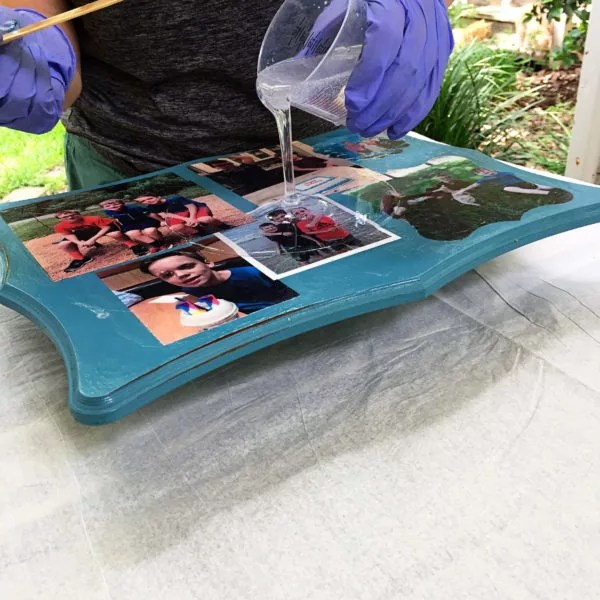 pouring resin onto a mothers day diy gift photo board