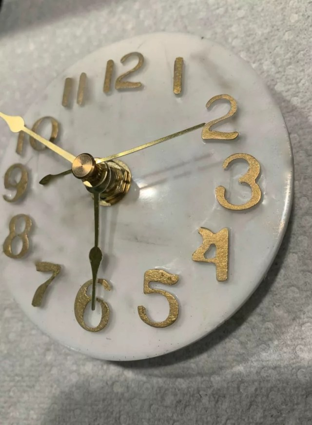 completed resin clock with mechanism in place