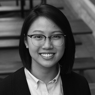 headshot of Judith Lao wearing glasses grayscale photo