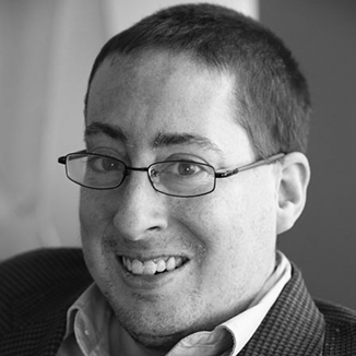 headshot of Justin Chappell wearing glasses grayscale photo