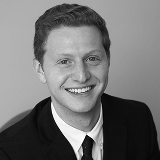 headshot of Matt Lerner wearing a suit and tie grayscale photo