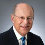 headshot of Ronald Glancz wearing glasses and a blue tie color photo