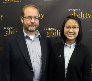 Judith Lao standing in front of the RespectAbility wall with Kevin Webb