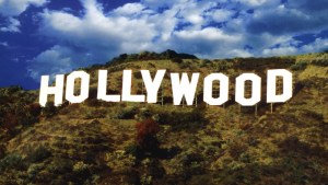 letters spelling out Hollywood on top of a mountain with trees