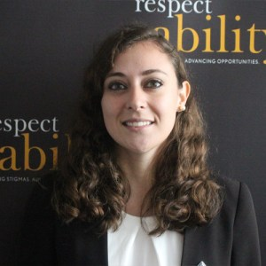 Respectability fellow Jeanette Marquez smiling in front of the RespectAbility banner