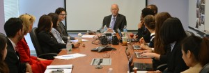 Patrick McCarthy speaking to RespectAbility Fellows seated around a large brown table