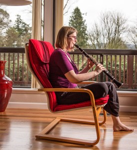 Jenny Lay Flurrie playing the clarinet on her deck