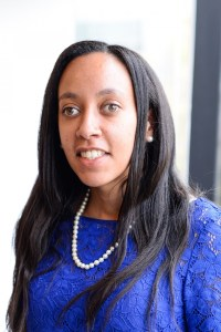 headshot of Haben Girma wearing a blue dress and pearls