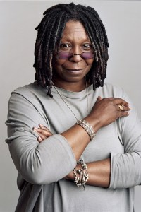 Whoopi Goldberg headshot wearing a gray sweater