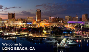 """Photo of downtown Long Beach at night with the text """"Welcome to Long Beach, CA"""" in the bottom left."""