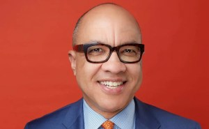 Darren Walker Headshot against a red background