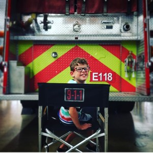 Gavin McHugh on the set of 9-1-1 in front of a firetruck