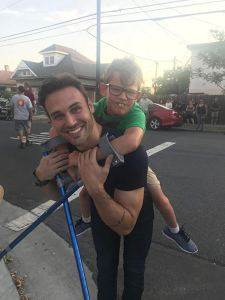 Gavin McHugh getting a piggy-back ride from his father on the set of 9-1-1