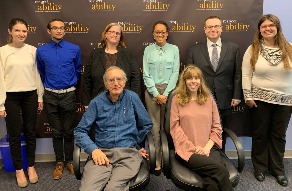 Bob Rudney with RespectAbility staff and Fellows in front of the RespectAbility banner