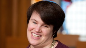 Lauren Tuchman inside a synagogue smiling