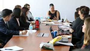 Donna Walton speaking with RespectAbility Fellows around the conference room table