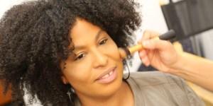Tatiana Lee having makeup put on her face