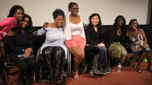 Six women of color with disabilities at the Women of Color Disability Summit on stage together, smiling