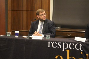 Philip sitting behind a table, participating in RespectAbility's final panel of the 2019 Summit
