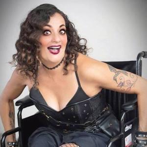 Filmmaker Diana Romero In A Wheelchair Dressed In All Black