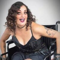 Filmmaker Diana Romero In A Wheelchair Dressed In All Black